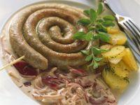 Bratwurstschnecke mit Bratkartoffeln (Plaaten in de Pann)