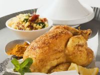 Curryhuhn mit Zucchini-Dattel-Cousous