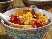 Fruchtiges Hähnchencurry mit Tomaten