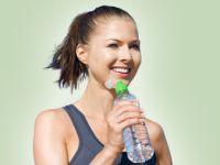 Sportlerin mit Wasserflasche