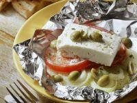 Käse mit Tomaten und Zwiebeln in der Folie