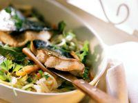 Karpfenfilets auf Gemüse