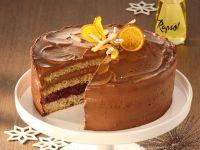 Orangen-Glühwein-Torte mit Zimt-Kirschen und Schokoladensahne