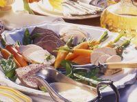 Pochiertes Fleisch mit Zitronensoße