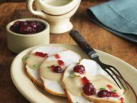 Putenbrust mit cremiger Sauce und Cranberries
