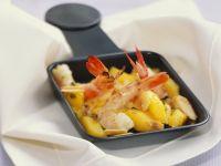 Raclette mit Mango und Garnele