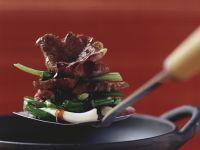Rindfleisch mit Lauchzwiebeln und Austernsoße