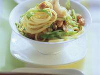 Spaghetti mit Fisch und Zuckerschoten