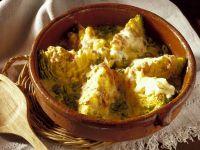 Wirsing mit Käse und Schinken gratiniert