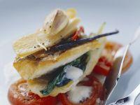 Zanderfilet auf Tomaten und schaumiger Buttermilchsoße