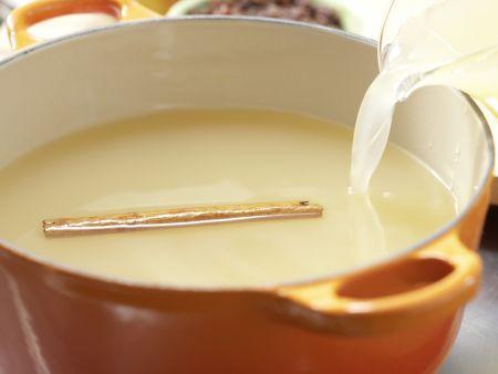 Apfelpunsch mit Rosinen: Zubereitungsschritt 1