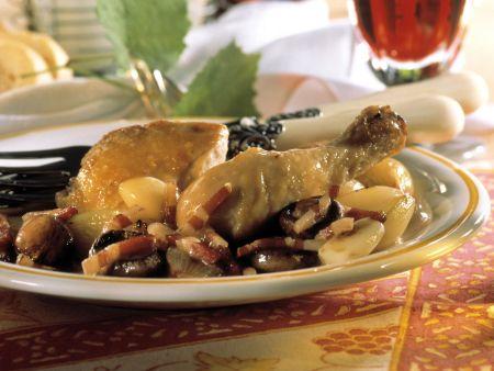Coq au vin mit Speck und Knoblauch