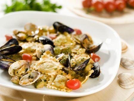 Fisch-Ravioli mit Muschelsoße