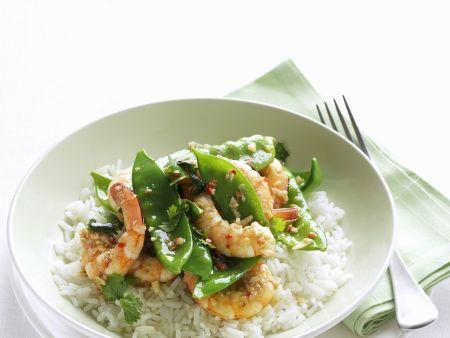 Garnelen mit Chili und Knoblauch mariniert dazu Zuckerschoten und Reis
