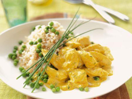 Geflügelcurry mit Erbsen und Reis