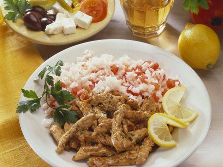 Gegrillte Schweinefleischstreifen (Gyros) mit Tomatenreis und Feta-Salat