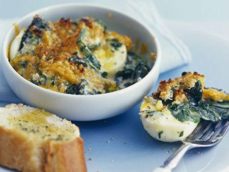 Harte Eier mit Käse und Spinat