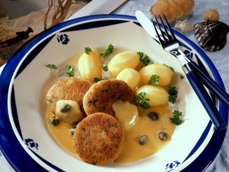 Heringsbuletten mit Kartoffeln und Kapernsoße