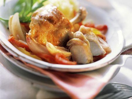 Kaninchen und Paprika-Zwiebel-Gemüse mit Wermutsoße