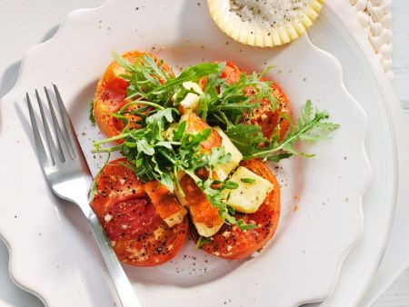Karamellisierte Tomaten mit Rucola und Halloumi
