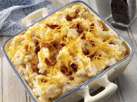 Kartoffelbrei mit Cheddar-Käse und Schinkenstreifen
