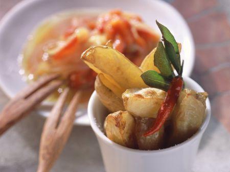 Kartoffelsticks mit Zwiebel-Paprika-Ragout