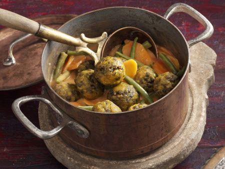 Linsenbratlinge mit geschmortem Gemüse