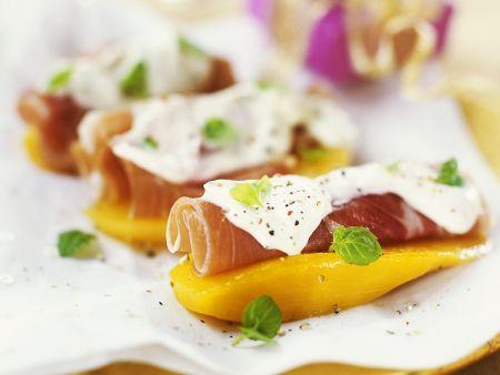Mango-Häppchen mit Serranoschinken