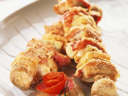 Matjesspieß mit Käse, Speck und Champignons in Panade
