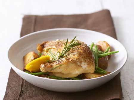 Ofengebackene Hähnchenkeulen mit Kartoffeln