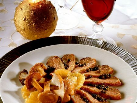 Orangen-Ente mit Pilzen