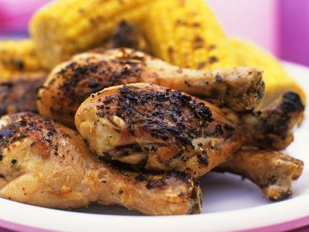 Scharfe Hähnchenschenkel mit Mais