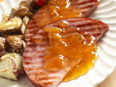 Schinken vom Grill mit Orangensoße und Kartoffeln