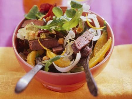 Straußenfleisch auf fruchtigem Salat