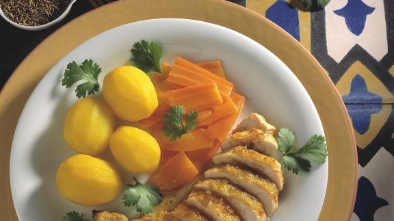 Rezept: Hähnchenbrust in Marinade, dazu karamellisierte Karotten und Safrankartoffeln