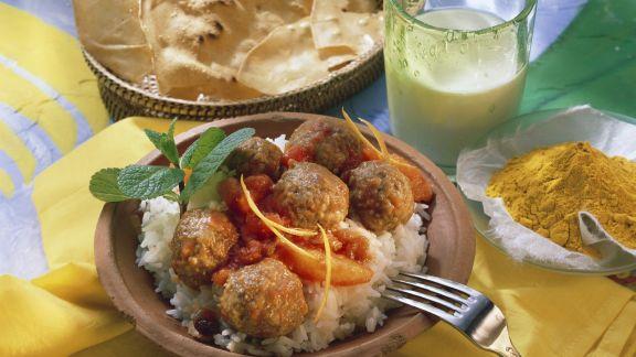 Rezept: Indische Hackbällchen mit Orangen-Tomatensoße und Reis