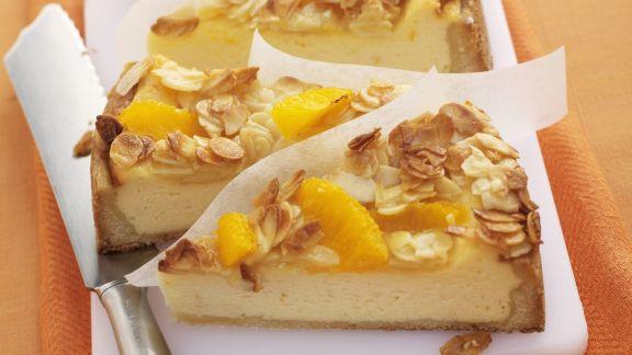 Rezept: Käsekuchen mit Orangen und Mandelblättchen
