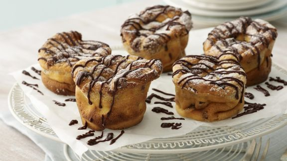 Rezept: Käsekuchen-Muffins mit Schokostreifen