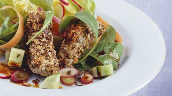 Rezept: Kürbiskern-Fischstäbchen mit Salat