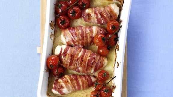 Rezept: Mit Käse gefüllte Hähnchenrouladen im Speckmantel