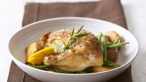 Rezept: Ofengebackene Hähnchenkeulen mit Kartoffeln