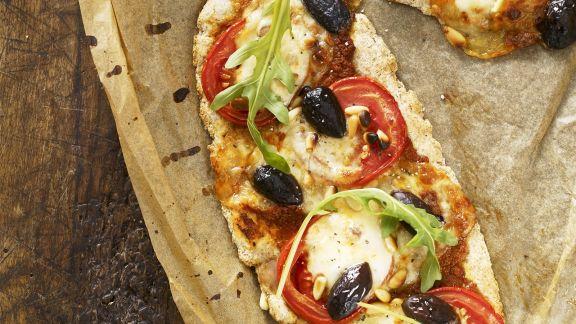 Rezept: Pizza mit Tomaten und Rucola