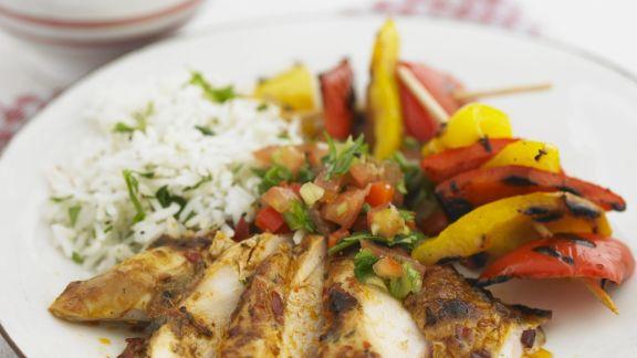 Rezept: Scharf marinierte Hähnchenschenkel mit gegrillter Paprika