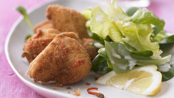 Rezept: Scharfes Zitronen-Backhähnchen mit Salat