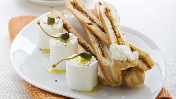Rezept: Ziegenkäse mit Kapern und Olivenöl dazu Gebäckstangen