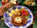 Kotelett mit Apfel und Petersilienkartoffeln Rezept