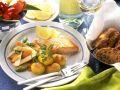 Lachs mit gebratenen Kartoffeln und Gemüse Rezept