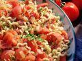 Pasta mit Tomaten und Speck Rezept