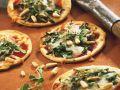 Pizza mit Rucola Rezept