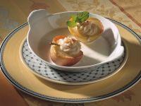 Apfelhälften mit Marzipan und Eissauce Rezept